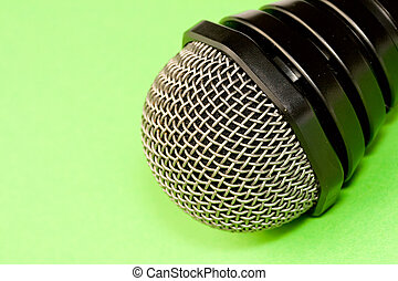 Microphone isolated on green background