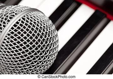 Microphone Laying on Electronic Keyboard