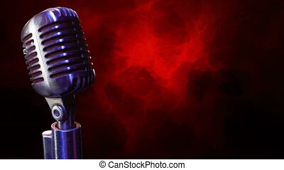 Microphone on a red and black background