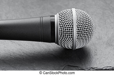 Microphone on a stone background