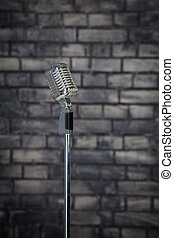 Microphone on brick wall background