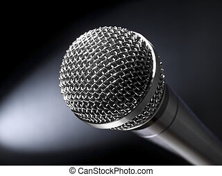 A dynamic microphone on stage. Bright spot light on the background.