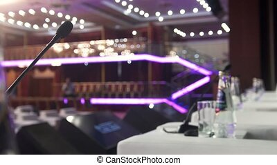 Microphone on stage in front of empty auditorium - business...