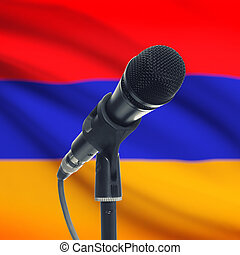 Microphone on stand with national flag on background - Armenia