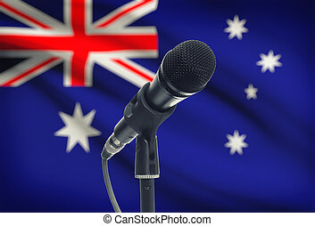 Microphone on stand with national flag on background - Australia