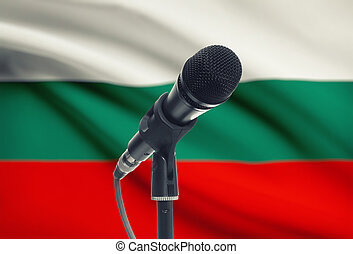 Microphone on stand with national flag on background - Bulgaria