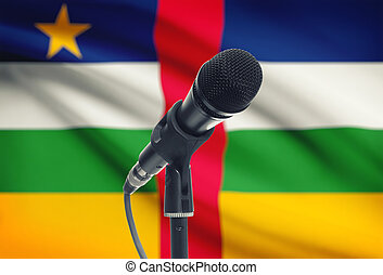 Microphone on stand with national flag on background - Central African Republic