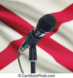 Microphone on stand with US state flag on background - Alabama