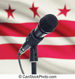 Microphone on stand with US state flag on background - District of Columbia