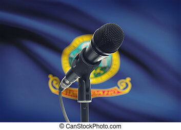 Microphone on stand with US state flag on background - Idaho...