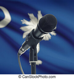 Microphone on stand with US state flag on background - South Carolina