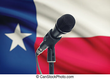 Microphone on stand with US state flag on background - Texas...