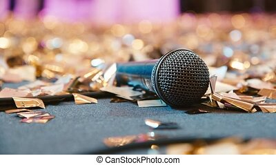 Microphone on the floor in confetti