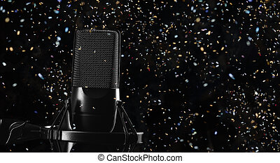 Microphone over black background
