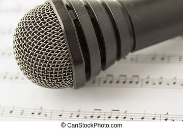 Microphone over score - Black microphone over musical score,...