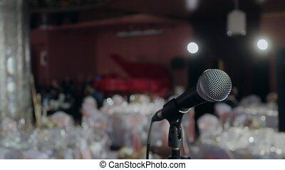 Microphone over the Abstract blurred conference hall or wedding banquet background