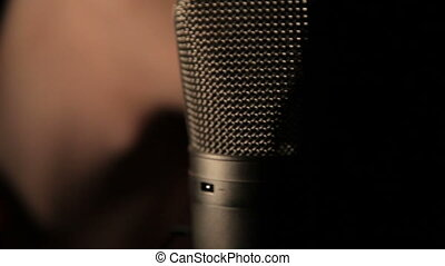 Microphone singer on a black background - The singer's...