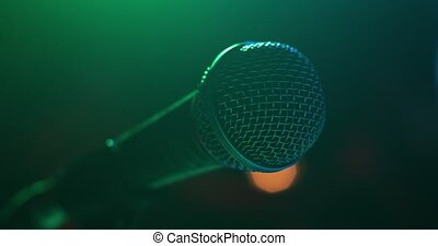 microphone stands on a tripod in nightclub - the microphone...