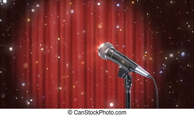 Microphone with Magic Particles against Blurred Red Curtains...