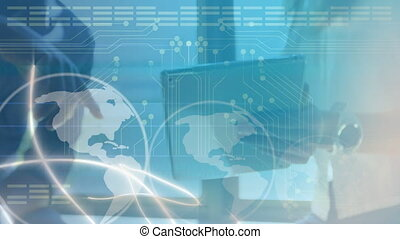 Animation of data processing and globe spinning over man and woman working in an office using digital tablet. Global business, technology, network of connections concept digital composite.