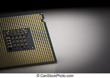 Macro shot of microprocessor with shallow depth of field on grey gradient
