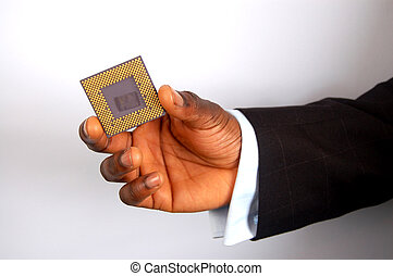 This is an image of a hand holding a microprocessor.