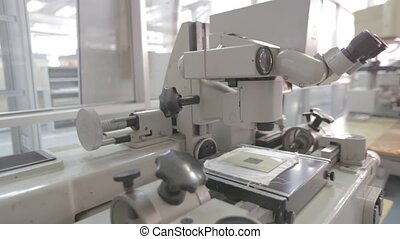 Microscope in a laboratory - Researchers working. Equipment...