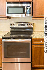 Microwave and Oven in New Kitchen