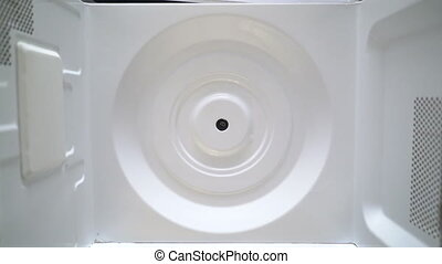 Microwave cleaning top view. Men's hands in protective...
