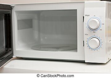 Open, white microwave oven