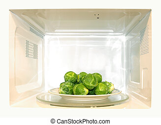 Microwave oven with Brussel sprouts
