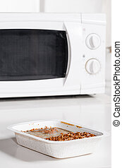 microwave oven with frozen food