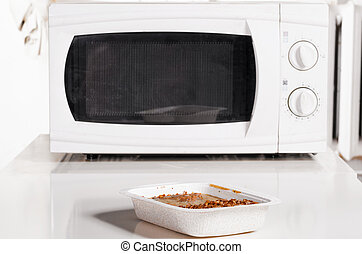 microwave oven with frozen food - microwave oven with...