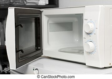 Microwave - Empty microwave oven with open door