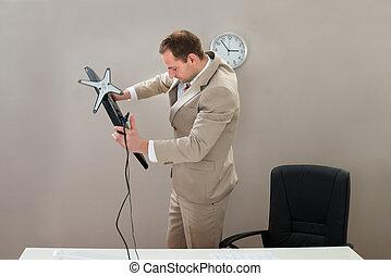 Businessman Lifting Desktop Computer