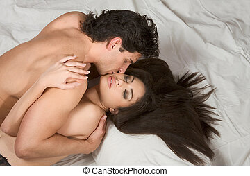 Mid adult Caucasian men in late 30s and young Hispanic woman...
