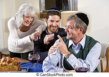 Mid-adult Jewish man at home with senior parents