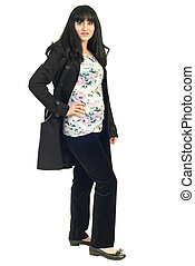 Mid adult woman in black jacket - Full length of mid adult...