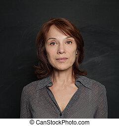 Mid adult woman on black background