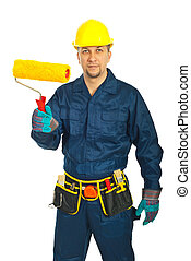 Mid adult worker man in uniform holding paint roller...