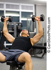 mid age man doing heavy weight exercise