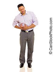 mid age man having stomach ache