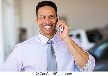 mid age man talking on smart phone