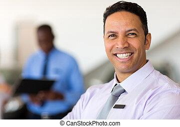 mid age vehicle dealer close up