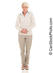mid age woman having stomach ache isolated on white ...