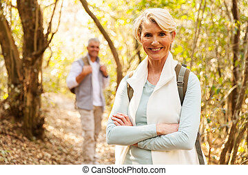 mid age woman hiking with husband