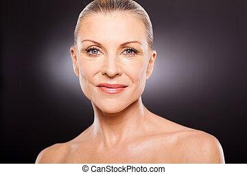 mid age woman portrait - portrait of pretty mid age woman on...