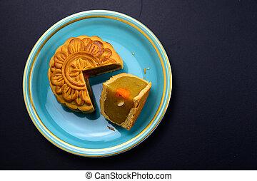 Mid-Autumn Festival moon cakes dish on black table