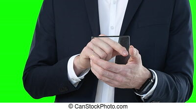 Mid section of a Caucasian man holding a transparent screen ...