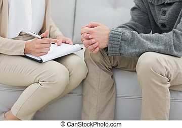 Mid section of a financial adviser and man
